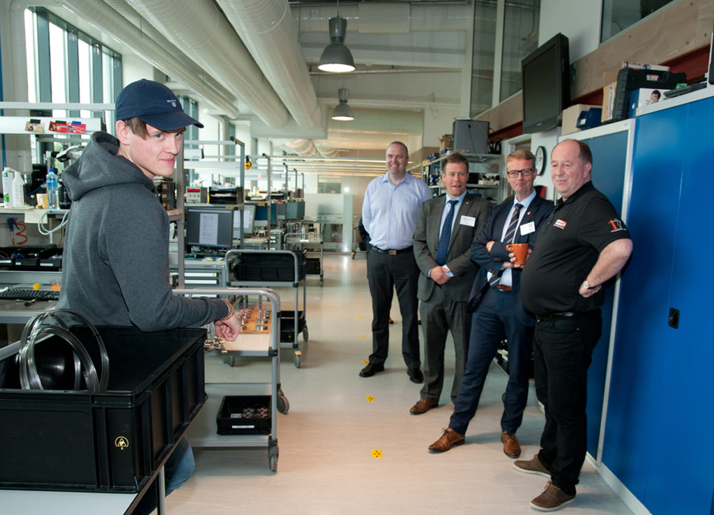 The Oil & Energy Minister talking to one of the apprentices, Tobias Gustavsen Framnes in production department.